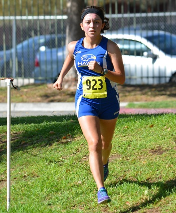 Student running at Foothill Invitational